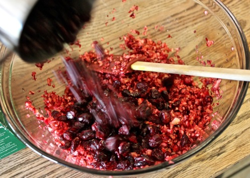 Adding in the dried cranberries